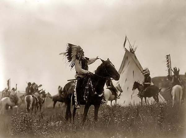Here for your browsing pleasure is a majestic photo a Indian Warrior in a War Bonnet. It was made in 1907 by Edward S. Curtis.    The illustration documents Dakota man, wearing war bonnet, sitting on horseback, his left hand outstreched toward tipi in background, others on horseback.    We have compiled this collection of artwork mainly to serve as a vital educational resource. Contact curator@old-picture.com.    Image ID# FCF4704A
