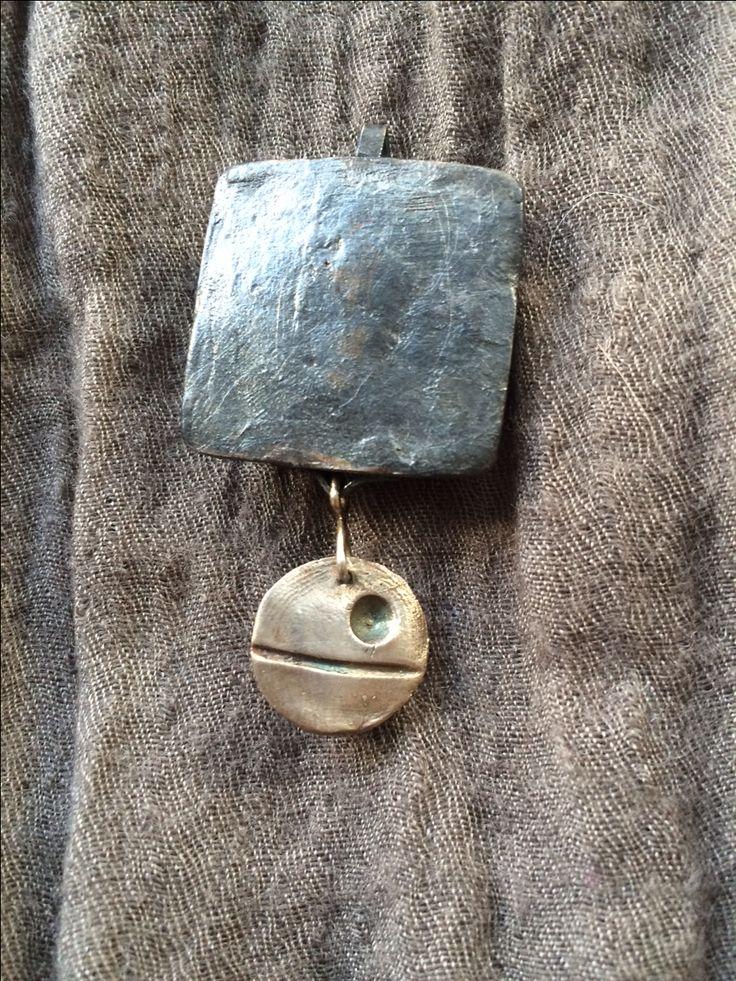Back of custom Ewok pendant with hidden Death Star. Fine silver/silver clay.