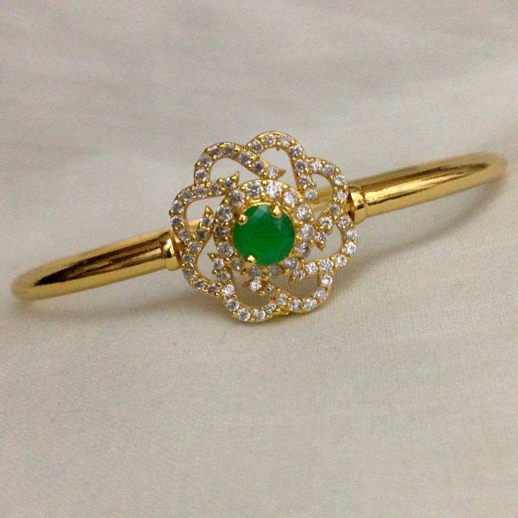 Flower model CZ and emerald stone kada Code : BAK 381 Price : 700/- Whatsapp to 09581193795/- for order processing....