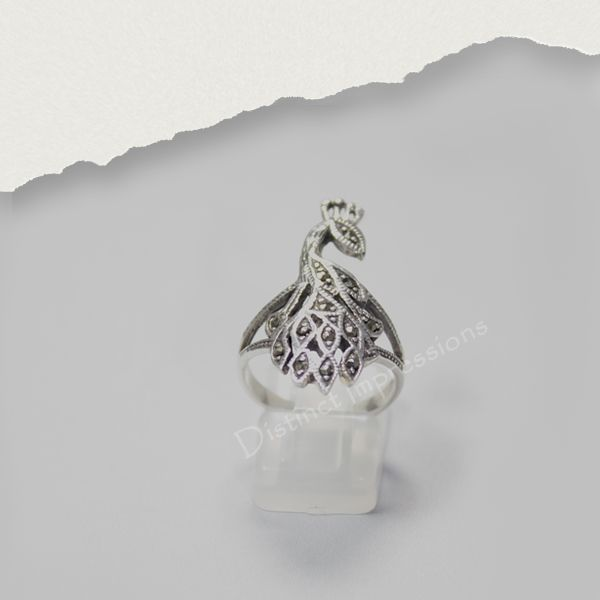 Add a fun touch to your wardrobe with this sterling silver ring. Crafted of sterling silver, the ring features intricate peacock design