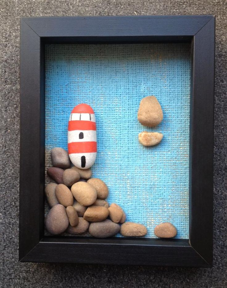 On the Rocks is a piece of stone art displayed in a black box frame. The stones are secured onto painted hessian.  The frame measure approx 23cm x 18cm