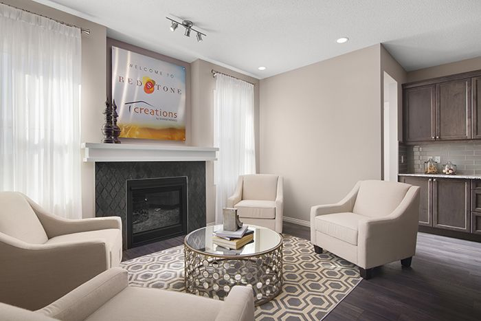 Rear living room in the Wysteria showhome in the community of Redstone in northeast Calgary