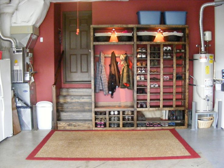 Garage Shoe Rack. This is fantastic, although for the coats I would put a pole in so you can hang more than 3. Plus storage ontop! Perfect!