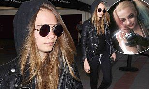 http://www.dailymail.co.uk/tvshowbiz/article-3214935/Cara-Delevingne-wears-comfortable-Chanel-kicks-getting-Suicide-Squad-tattoo-star-Margot-Robbie-wrap-filming.html