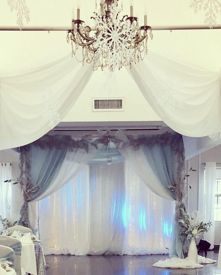 #cldesigns #cldesignteam #winterweddints #bluesilverandwhie #whitewedding #frosted #snowflakedecor #chandelier #ceilingdrapery #weddingarchway #ceremonycanopy