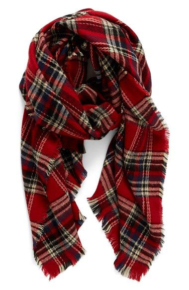 Could pretty much live in this oversized plaid scarf during the fall. So many options to layer with an exceptionally soft and cozy scarf featuring a classic plaid pattern and wispy fringed trim. On the Nordstrom Anniversary Sale.