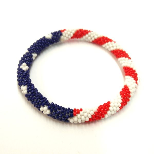 Handmade in Nepal | $5.50 — Design I  Get patriotic with our American flag bracelet, complete with stars and  stripes!  This roll on bracelet is hand-crocheted with cotton and glass beads by a  fair trade artisan group in Nepal. Each bracelet can stretch to roll on  over any hand.