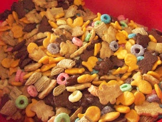 Kids trail mix, or snack mix.  Take their favorite shelf stable treats and mix them together.  This makes the more expensive snacks go further! One scoop is perfect for a snack bag size treat.