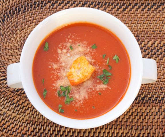 When the weather outside looks like this, there's only one sensible thing to do: make a big steamingpot of homemade soup.Or, if you're a really good sport, you could go sledding...but once you come inside, you should definitely treat yourselfto a bowl of this old-fashioned tomato soup. It'll warm your soul, and might even make you grateful fo