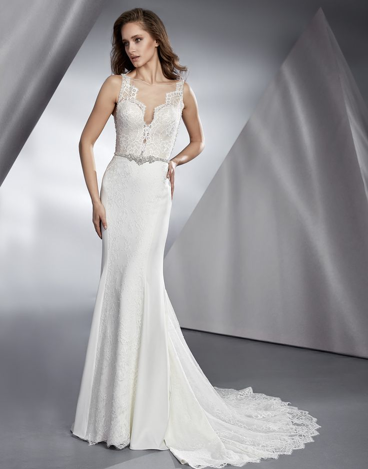 BEVERLY // A sleek and sexy wedding dress with a with elements of both lace and crepe gives this gorgeous wedding dress a vintage feel