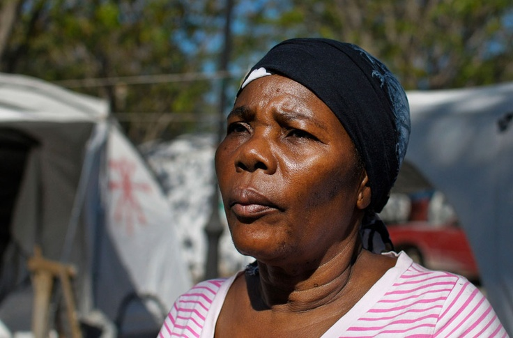 Lucienne Bounba stands outside her tent in a camp across the airport in Port-au-Prince January 10, 2012. Sixty-year-old Bounba moved into her own apartment recently after having lived at the camp following the January 2010 earthquake which destroyed her home in Carrefour. Haiti