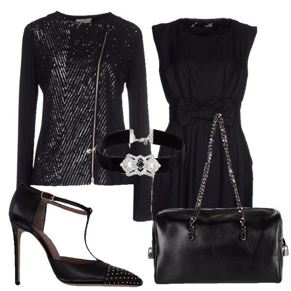 Di sera in total black non si sbaglia mai. Se indossate questo vestito con fiocco, la giacca con la parte anteriore in lurex e delle scarpe con t-bar e borchiette non passerete inosservate. Per completare il look raccogliete i capelli in uno chignon e l'effetto chic è assicurato.