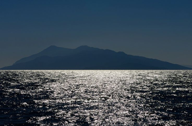 The island of Ikaria, Greece as seen from the little Panagia Theotokos ferry sailing from Karlovassi (Samos) to Agios Kirykos, Ikaria