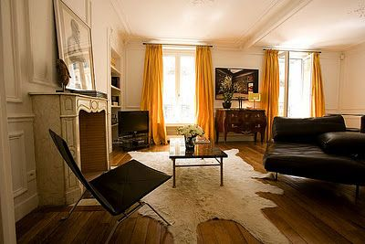 .: Living Rooms, Floors, Cups, Paris Travel, Paris Apartments, Colors, Yellow Curtains, Apartment Rental, Rugs
