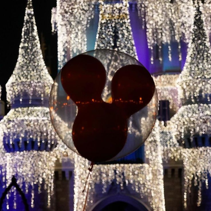 Mickey Mouse balloon floats in front of Cinderella Castle which is lit for the holidays. #disney #balloon #castle #wdw #disneyworld #disneyworld #magickingdom #twitter