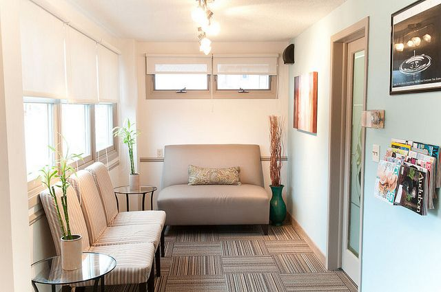 A 3 - season porch converted into a reception room at a chiropractic clinic. #waiting #clinic