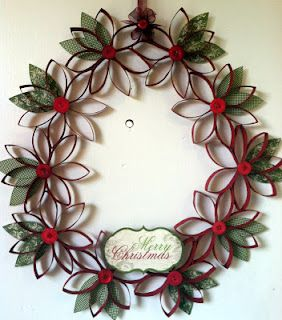 "Toilet paper roll wreath...cut rolls into 1/2"" pieces.  Paint.  Assemble, using 7 pieces per flower.  Use fabric or paper to make leaves and flower centers.   Glue together in a circle."