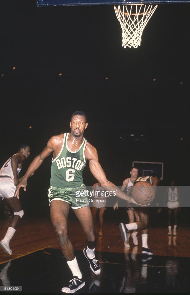 Boston Celtics' Bill Russell #6 takes the grabs the rebound to pass after a score by the New York Knicks at Madison Square Garden in New York, New York.