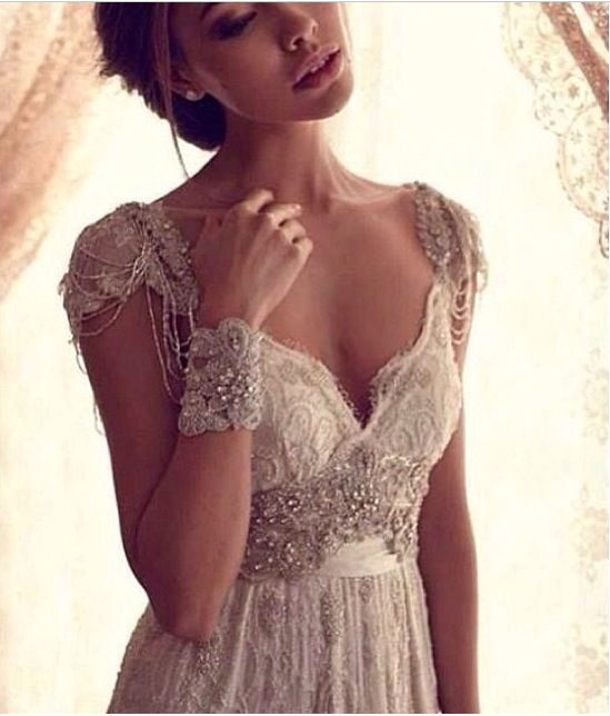Vintage wedding dress... Can the wristband, but the dress is gorgeous.
