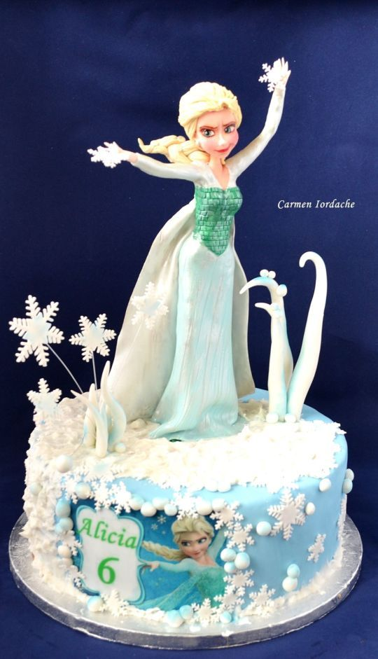 A VERY CUTE Princess Elsa cake perfect for a little girl's birthday who loves her.