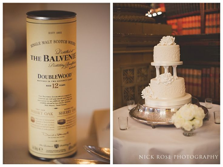 A simple white 2 tiered wedding cake at One Whitehall Place, London | Nick Rose Photography | www.nickrosephotography.com