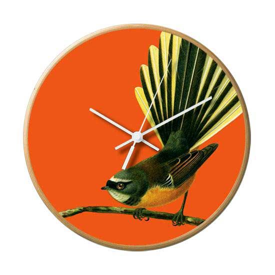 This fabulously bold and bright colour wall clocks features a wooden frame and the native New Zealand fantail (Maori name Piwakawaka) on orange. ThisBright and colourful wall clock has beendesigned in New Zealand. It is320mm across and featuresa silent movement with a blonde wood frame. The clocks are designed in New Zealand by well known photographer and artist, Reuben Price.