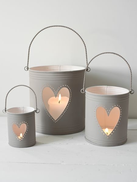 Heart Hurricane Lanterns...could totally diy this! love the gray with the pinkish glow :)