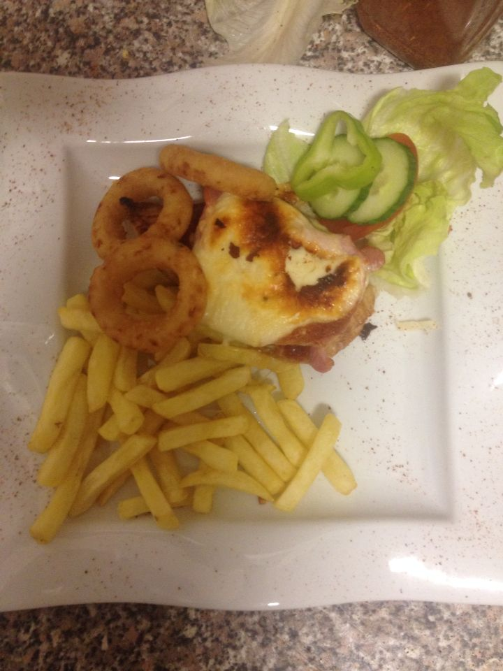 Chicken steak with bacon, cheese and onion rings
