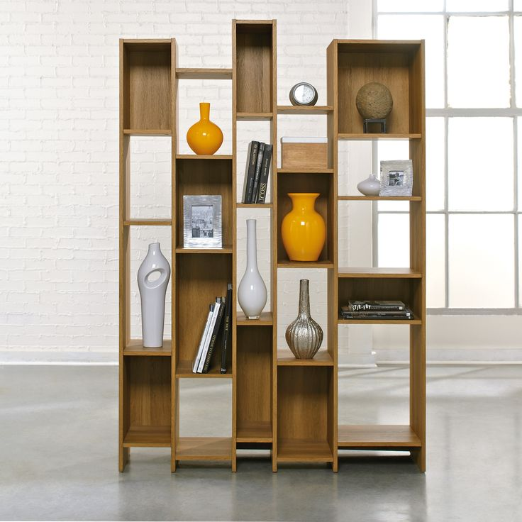 """Cubbyhole storage holds books, photos, collectibles, and more.Reversible backs display Pale Oak or Moccasin finish.Pale Oak finish.  Dimensions W:47 3/4"""" (121"""