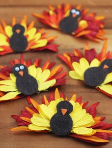 Brilliant! Make your Thanksgiving decorations bright and beautiful by using fake flowers to make turkeys!