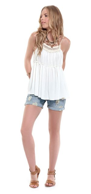 Pair a summer boho fringed top with denim shorts for a really cool morning outfit!