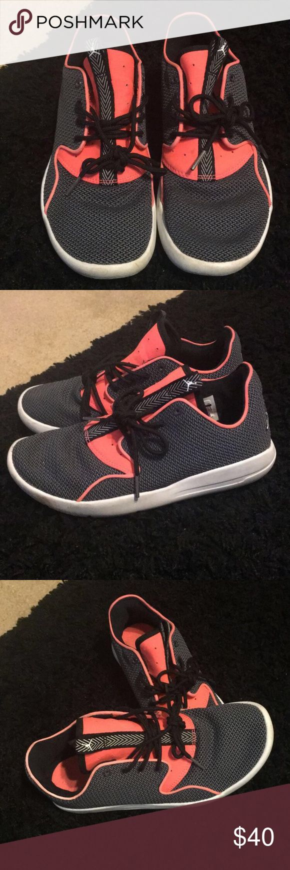 Air Jordan tennis shoes Excellent condition and barely worn! Bright coral and gray tennis shoes . Extremely comfortable and fashionable. Size 5 in kids but I wear a size 6 in woman's and they fit like a glove . Air Jordan Shoes Sneakers