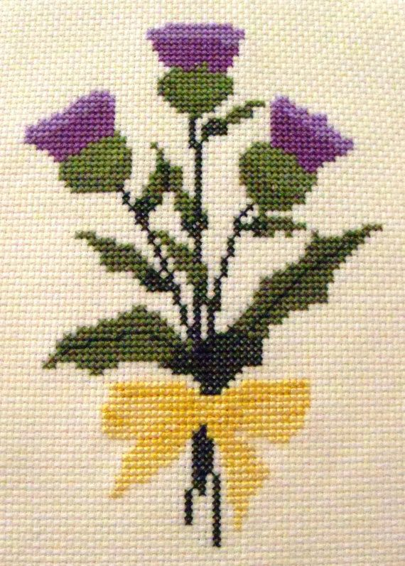 Three thistles, the flower of Scotland, tied with a yellow bow.    Pattern includes DMC floss color suggestions and complete instructions.