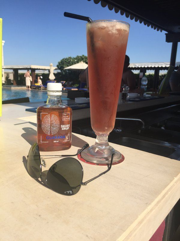Guarana Sparkler: a great mocktail for a productive day: cranberry juice, apple juice, #SmartSyrup Guarana, and ginger ale.  Mixologist's advice: Go light on the apple juice and heavy on ginger ale!