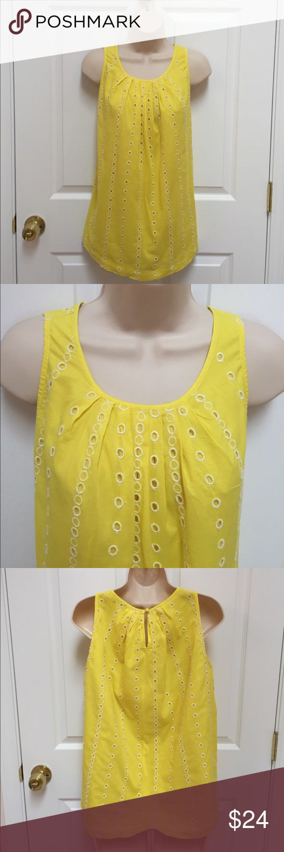 ANN TAYLOR LOFT SMALL YELLOW SMOCK SLEEVELESS Women's size small smock, sleeveless.  ANN TAYLOR LOFT BRAND.  Material is 100% cotton, all lined, lightweight and cool for summer.  Yellow with white embroidered eyelet circles .  EXCELLENT CONDITION, FRESHLY LAUNDERED AND PRESSED.  FREE FROM SMOKE AND PETS.  Thanks for looking! 👀. NCMCOLLECTIONS Ann Taylor Loft Tops Tunics