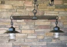 Single tree horse cart part used to hold lanterns as a light fixture. Very neat and rustic.