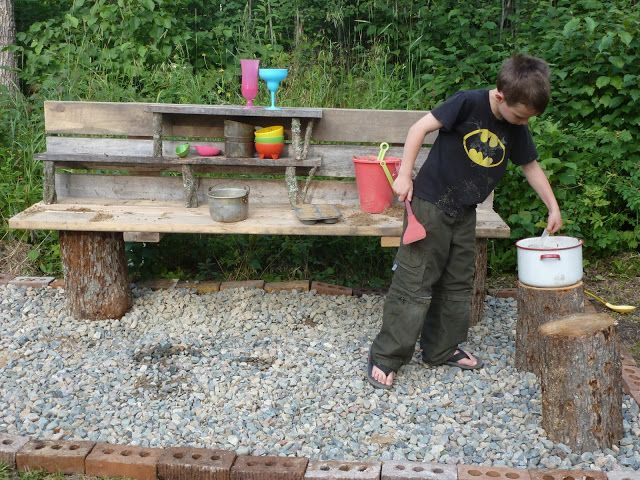 mud kitchen from stumps and scrap lumber