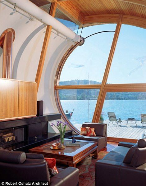 The wooden houseboat is roomy inside, with giant floor-to-ceiling windows allowing light to flood in