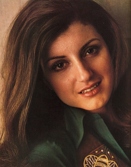 """Arianna Huffington, age 24:   The photo is a scan from Viva magazine, August 1974, in which she was interviewed about her views on """"the women's lib movement."""" She'd recently published a book, The Female Woman, which the magazine described as follows:  """"Her concept of the 'female woman' is of a person who combines feminity, intelligence, and independence, but without friction and without self-consciousness..."""""""
