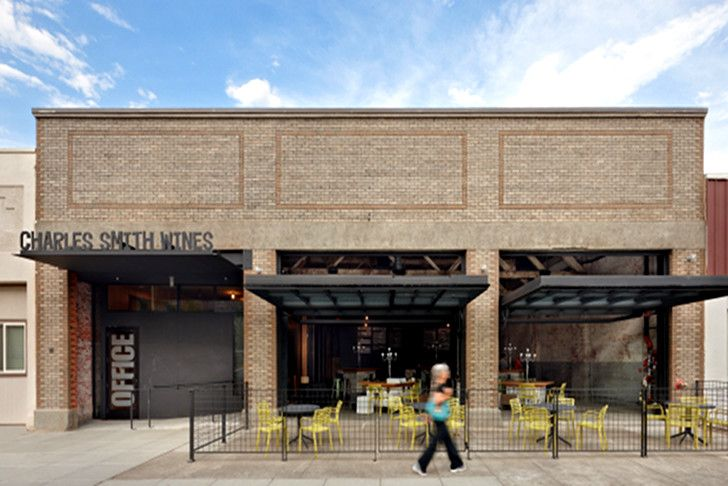 Olson Kundig Architects transforms an old automotive garage into a multi-purpose wine tasting room for Charles Smith Wines.
