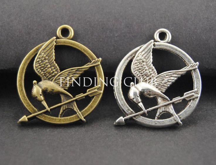 Aliexpress.com: Comprar Envío gratis! 30 unids estilo antiguo Hunger Games colgantes encantos de la joyería colgante pájaro y flecha Charm de colgante de vela fiable proveedores en FindingClub