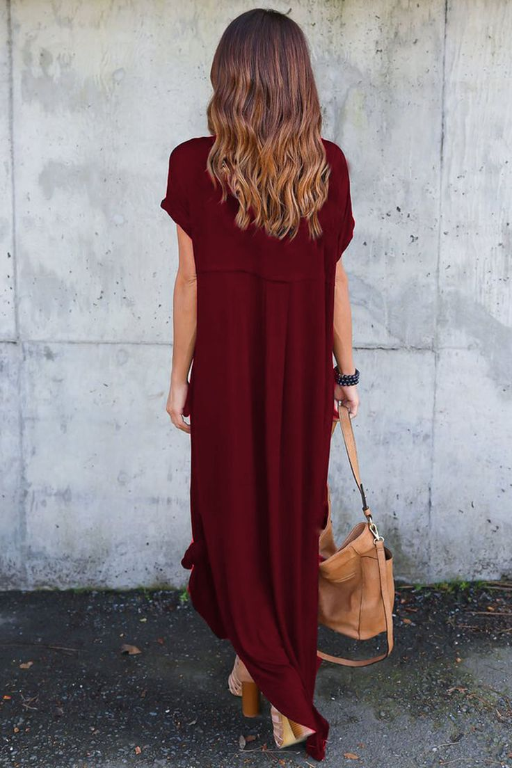 The dress is featuring v neck, short sleeve, side slit, loose fit, solid color and maxi length.