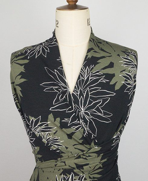 white & khaki leaf-printed viscose jersey fabric