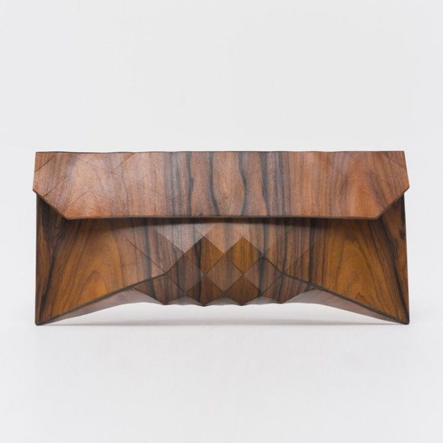 Tesler + Medelovitch (http://www.tesler-mendelovitch.com/), design duo based in Tel-Aviv, has designed a series of beautiful wooden clutches. $580 - $680 each! Found on Fubiz