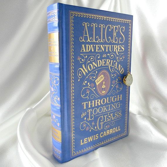 Hey, I found this really awesome Etsy listing at http://www.etsy.com/listing/127966341/book-clutch-purse-alices-adventures-in