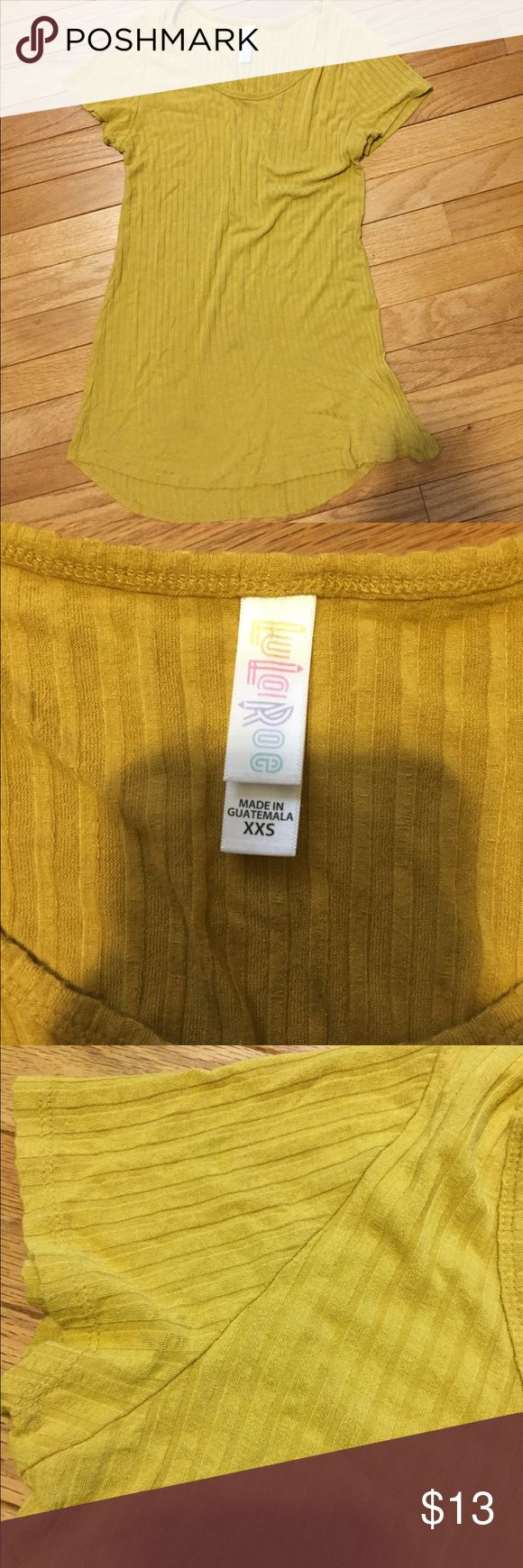 LuLaRoe Top LuLaRoe Top Short sleeve  Ribbed  Mustard yellow color Size xxs Please note: the wrinkles seen on the bottom of the shirt on the right side of the photo is from tying up that side of the shirt. It is not a defect LuLaRoe Tops Tees - Short Sleeve