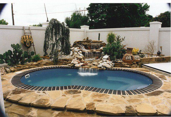 outdoor kidney shaped pool with spectacular water feature waterfall natural stones