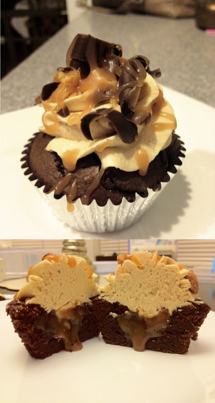 Snickers Cupcakes - chocolate cupcakes filled with caramel, topped with peanut butter buttercream, chocolate curls, a drizzle of caramel and chopped peanuts.