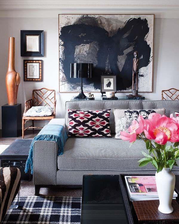 Abstract artwork | Javier Castilla | gray sofa | plaid rug