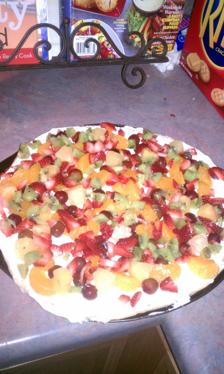 Fruit Yummy pizza.   Bake sugar cookie dough on a pizza pan as dough says.   Let completely cool.  Beat 8 oz cream cheese and tub of cool shop and spread over pizza.  Cut up whatever fruit and sprinkle over pizza.  Keep pizza cold.    Easy and good!